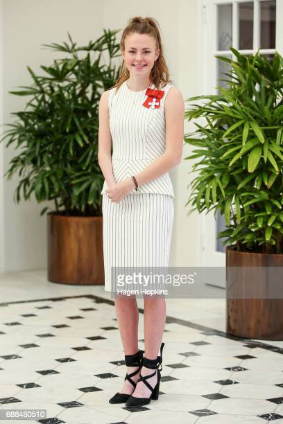 Paralympian Anna Grimaldi poses after receiving the New Zealand Order of Merit for services to athletics at Government House on May 26 2017 in...