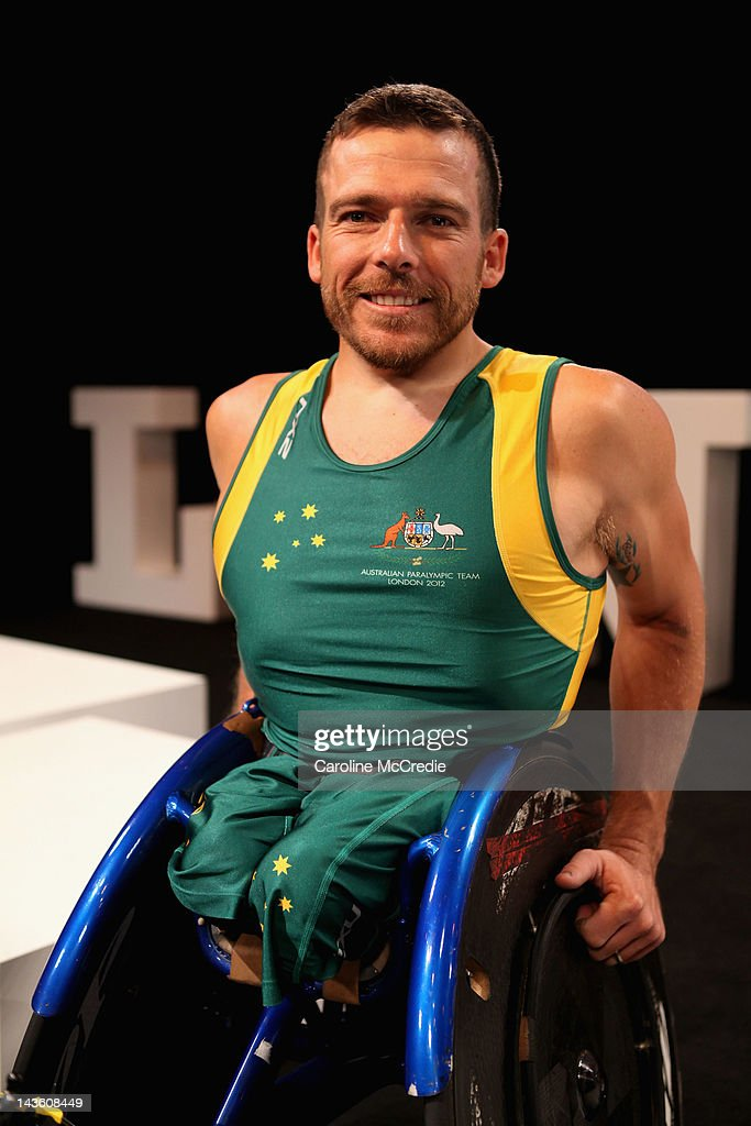 Paralympian Kurt Fearnley showcases the 2012 Australian Paralympic team uniform on the catwalk on day two of Mercedes-Benz Fashion Week Australia Spring/Summer 2012/13 at Overseas Passenger Terminal on May 1, 2012 in Sydney, Australia.