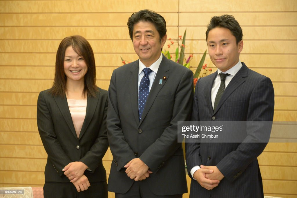 Paralympian Mami Sato, Prime Minister Shinzo Abe and Olympic double silver medalist in fencing Yuki Ota pose for photographs as 2020 Tokyo Bid committee members making a courtesy visit at Abe's official residence on September 17, 2013 in Tokyo, Japan.