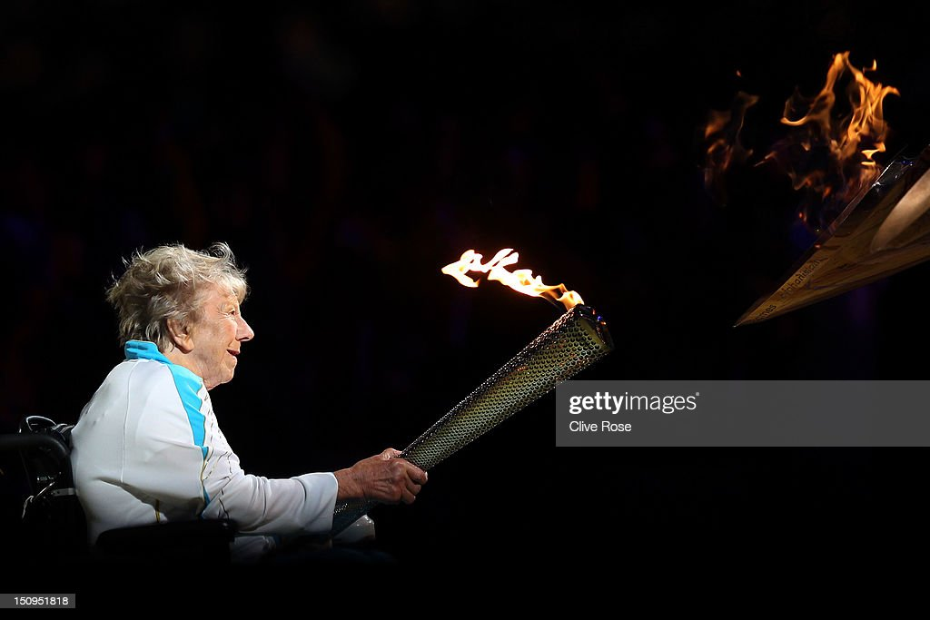 Paralympian Margaret Maughan lights The Paralympic Cauldron during the Opening Ceremony of the London 2012 Paralympics at the Olympic Stadium on August 29, 2012 in London, England.