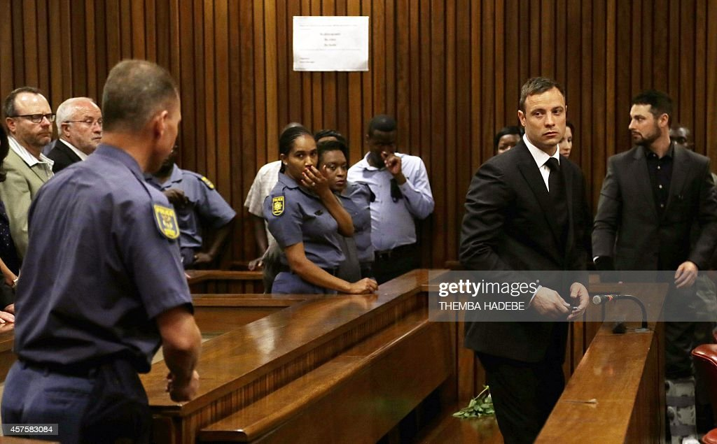 Paralympian Oscar Pistorius turns to leave the dock follwoing his sentencing at the high court in Pretoria on October 21 2014 South Africa's star...