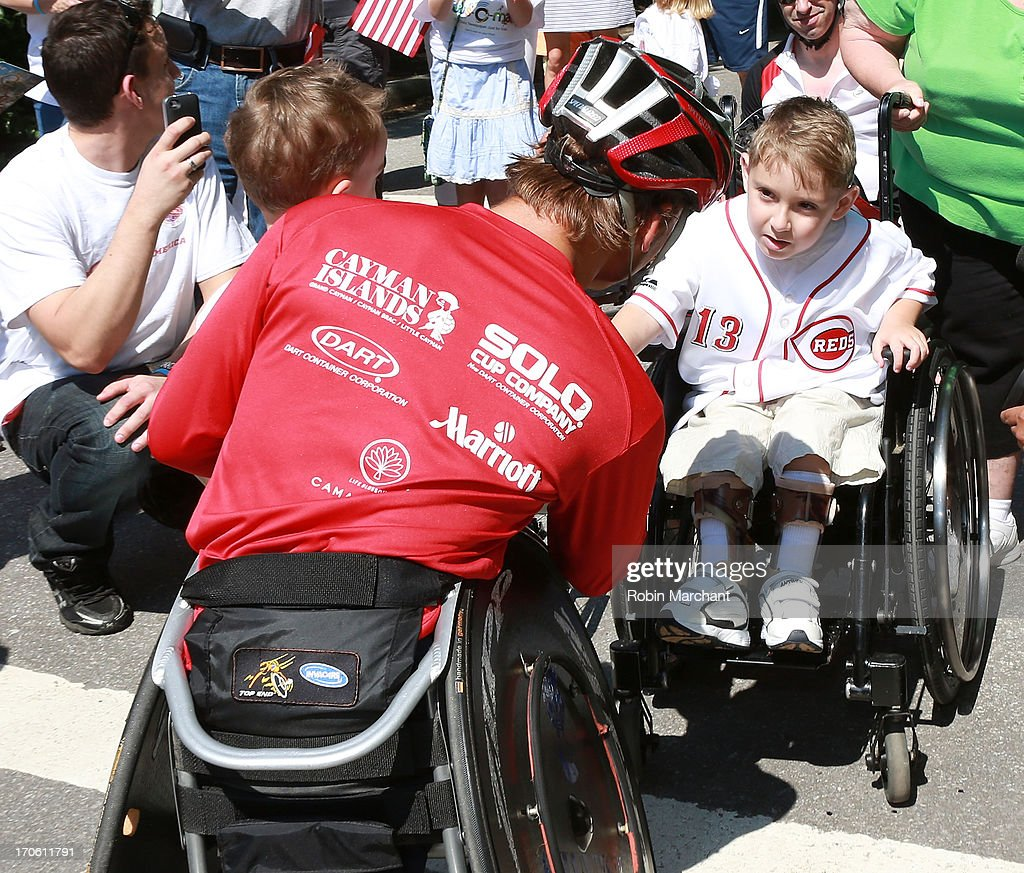 Paralympian Ryan Chalmers (C) with fans after completing 3,000 Mile Push Across America Benefitting Disabled Scuba Diving In the Cayman Islands on June 15, 2013 in New York City.