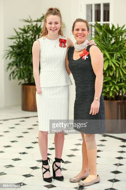 Paralympians Anna Grimaldi and Kate Horan pose after receiving the New Zealand Order of Merit for services to athletics and Paralympic sport...