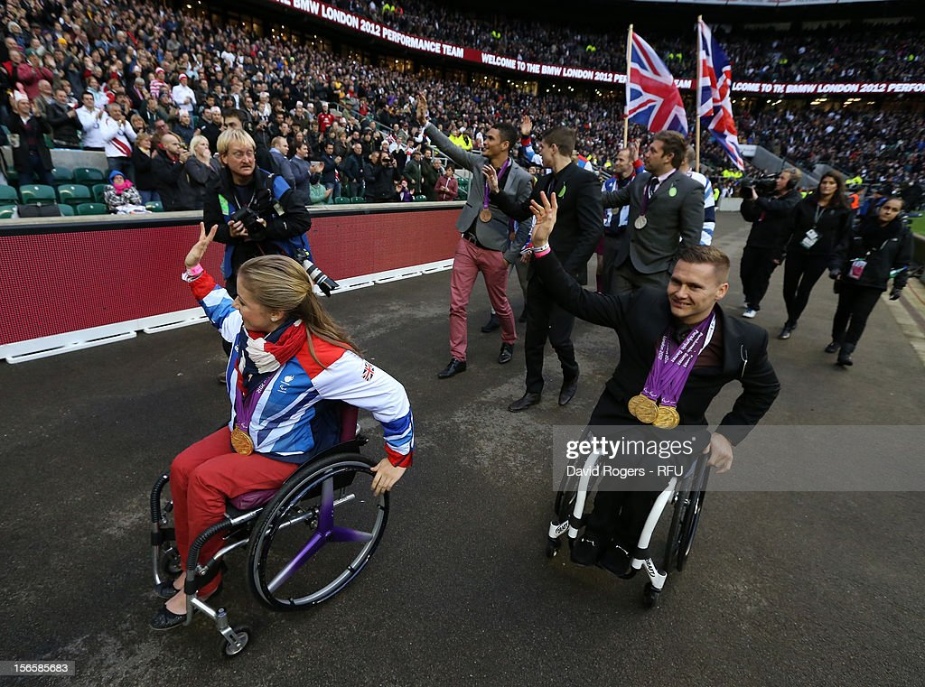 Paralympians <a gi-track='captionPersonalityLinkClicked' href=/galleries/search?phrase=Hannah+Cockroft&family=editorial&specificpeople=7441060 ng-click='$event.stopPropagation()'>Hannah Cockroft</a> (L) and David Weir (R) parade around the stadium at half time during the QBE International match between England and Australia at Twickenham Stadium on November 17, 2012 in London, England.
