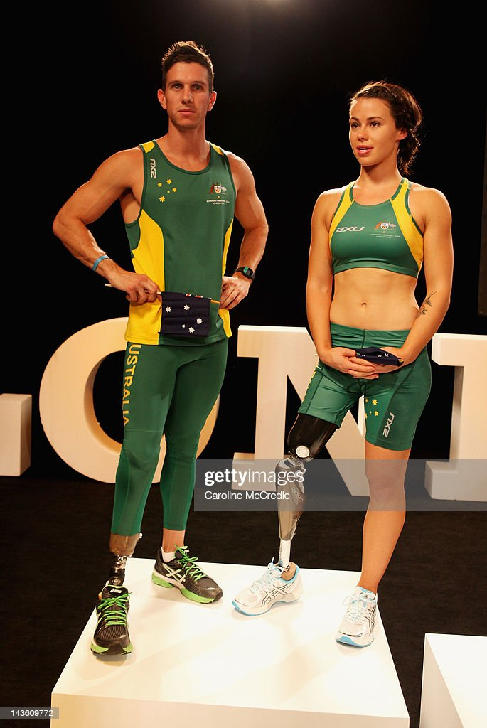 Paralympians Jack Swift and Kelly Cartwright showcase the 2012 Australian Paralympic team uniform on the catwalk on day two of Mercedes-Benz Fashion Week Australia Spring/Summer 2012/13 at Overseas Passenger Terminal on May 1, 2012 in Sydney, Australia.