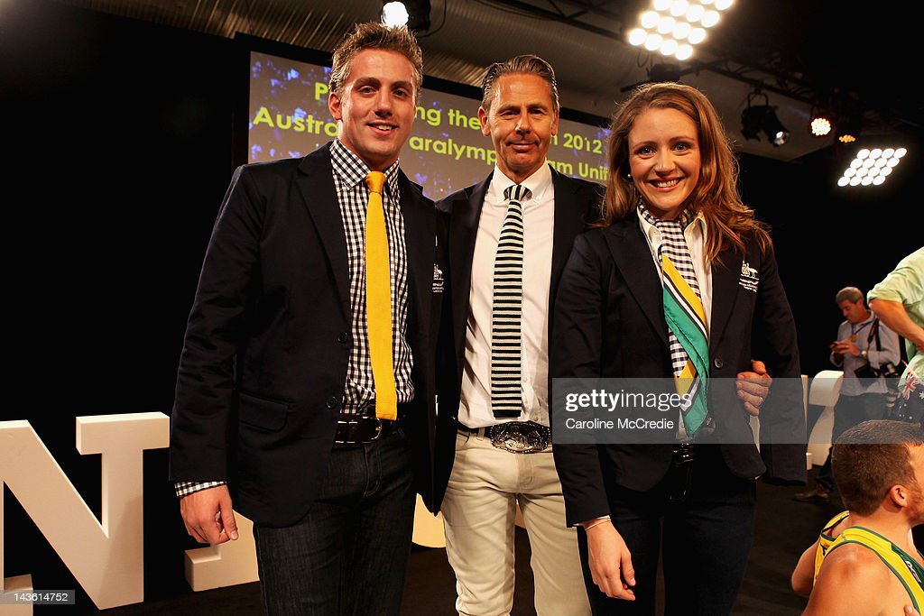 Paralympians Matt Cowdrey (L) and Annabelle Williams (R) pose with Head designer from RM Williams, Jonathan Ward at the 2012 Australian Paralympic team uniform launch on day two of Mercedes-Benz Fashion Week Australia Spring/Summer 2012/13 at Overseas Passenger Terminal on May 1, 2012 in Sydney, Australia.