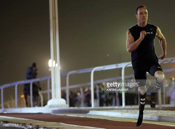 Paralympic and Olympic runner Oscar Pistorius of South Africa races against a purebred Arabian horse during the Gathering of all Leaders In Sport...