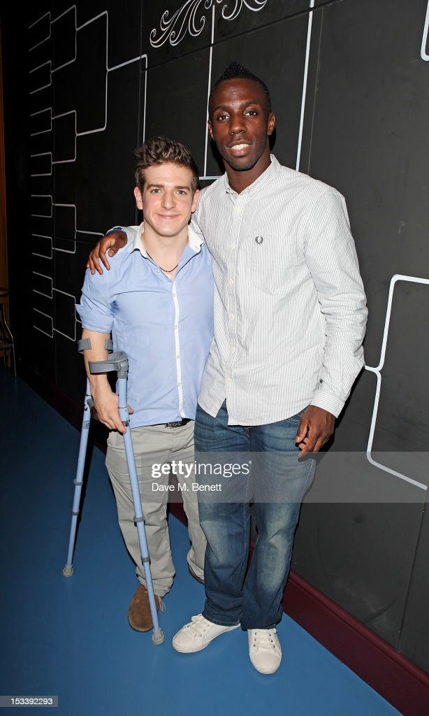 Paralympic athlete David Wetherill (L) and Olympian Darius Knight attend the launch of Bounce, Holborn's new Ping Pong club, on October 4, 2012 in London, England.