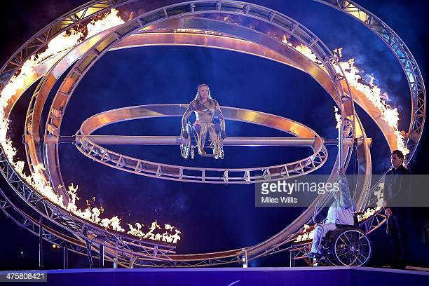 Paralympic athlete Hannah Cockroft sits in the Armillary Sphere as Caz Walton OBE lights the torch to celebrate the Winter Paralympic Games in Sochi...