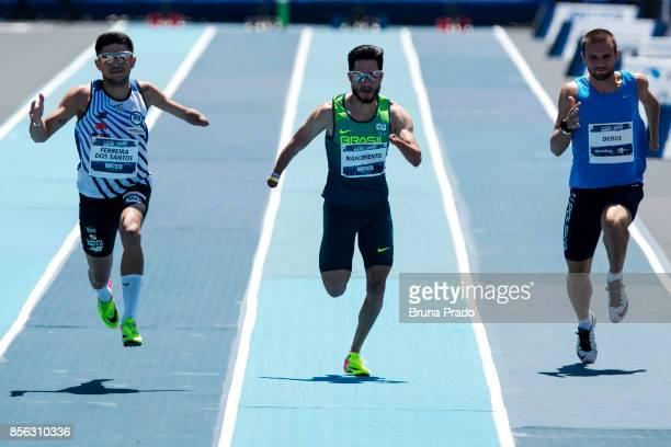 Paralympic athletes Petrucio Ferreira of Brazil Yohansson Nascimento of Brazil and Michal Derus of Poland during the Mano a Mano Athletics Challenge...