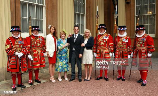 Paralympic cyclist Mark Colbourne and members of his family with the Yeoman of the Guard after receiving his Member of the British Empire medal from...