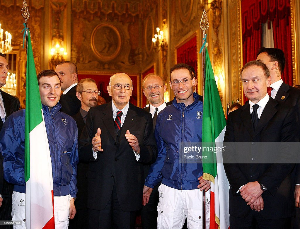 Paralympic flag bearer Giammaria Dal Maistro, President <a gi-track='captionPersonalityLinkClicked' href=/galleries/search?phrase=Giorgio+Napolitano&family=editorial&specificpeople=568986 ng-click='$event.stopPropagation()'>Giorgio Napolitano</a>, <a gi-track='captionPersonalityLinkClicked' href=/galleries/search?phrase=Giorgio+Di+Centa&family=editorial&specificpeople=770851 ng-click='$event.stopPropagation()'>Giorgio Di Centa</a> flag bearer for the Italian Olympic team for Vancouver 2010 and Gianni Petrucci of C.O.N.I. pose during a meeting at Quirinale palace on January 18, 2010 in Rome, Italy.