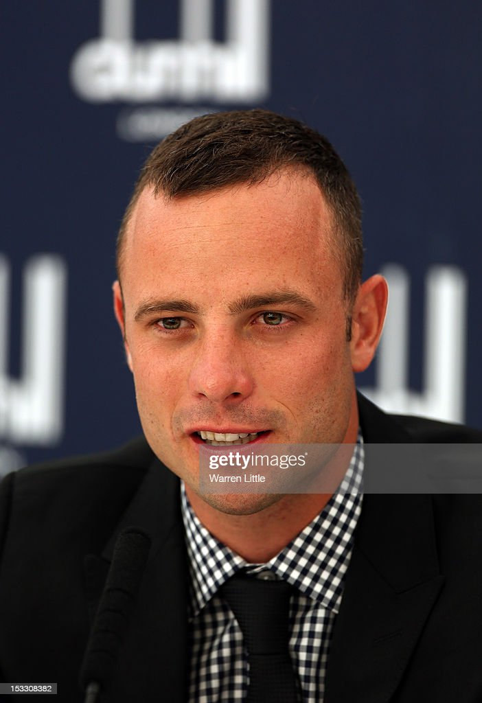 Paralympic gold medallist <a gi-track='captionPersonalityLinkClicked' href=/galleries/search?phrase=Oscar+Pistorius&family=editorial&specificpeople=224406 ng-click='$event.stopPropagation()'>Oscar Pistorius</a> of South Africa talks to the media at his press conference during the practice round of The Alfred Dunhill Links Championship at The Old Course on October 3, 2012 in St Andrews, Scotland.