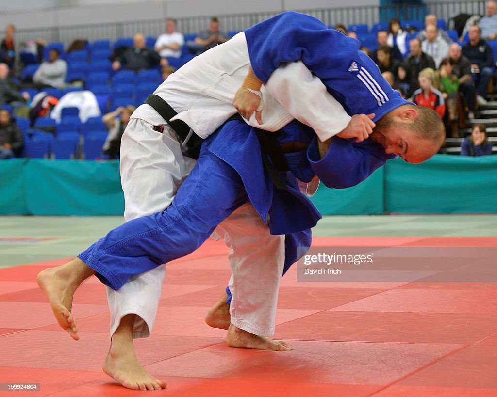 Paralympic silver medallist, Sam Ingram of Edinburgh (blue) attacking here, defeated Frazer Chamberlain of Camberley by ippon from a strangle during their u90kgs pool contest at the British Senior Judo Championships on Sunday, January 20, 2013 at the English Institute of Sport, Sheffield, England, UK.