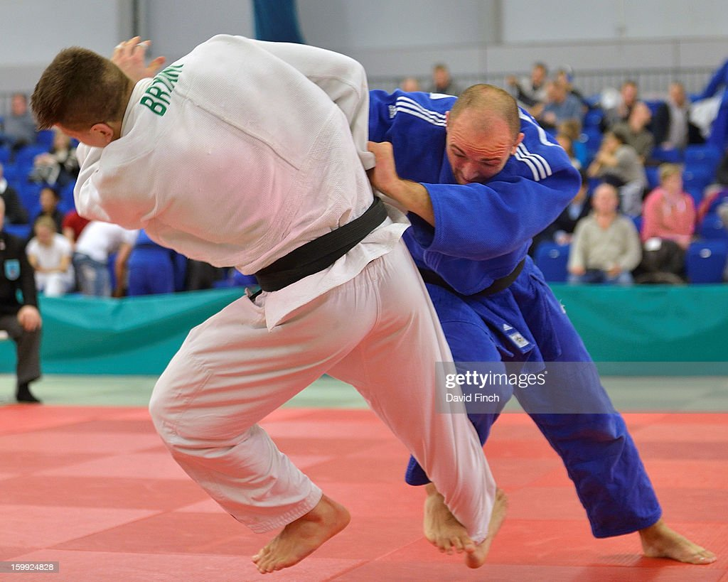 Paralympic silver medallist, Sam Ingram of Edinburgh (blue), here attacking with a foot sweep, defeated Frazer Chamberlain of Camberley by ippon from a strangle during their u90kgs pool contest at the British Senior Judo Championships on Sunday, January 20, 2013 at the English Institute of Sport, Sheffield, England, UK.