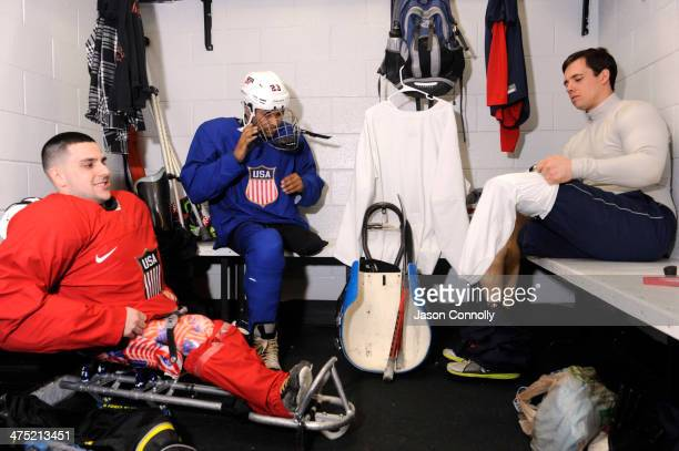 S Paralympic Sled Hockey Team athletes Kevin McKee Rico Roman and Andy Yohe ready their equipment prior to the team's practice at the Sertich Ice...