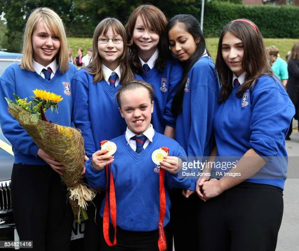Paralympic swimmer Eleanor Simmonds who is Britain's youngest ever individual Paralympic gold medallist is welcomed back by classmates Amber Evans...
