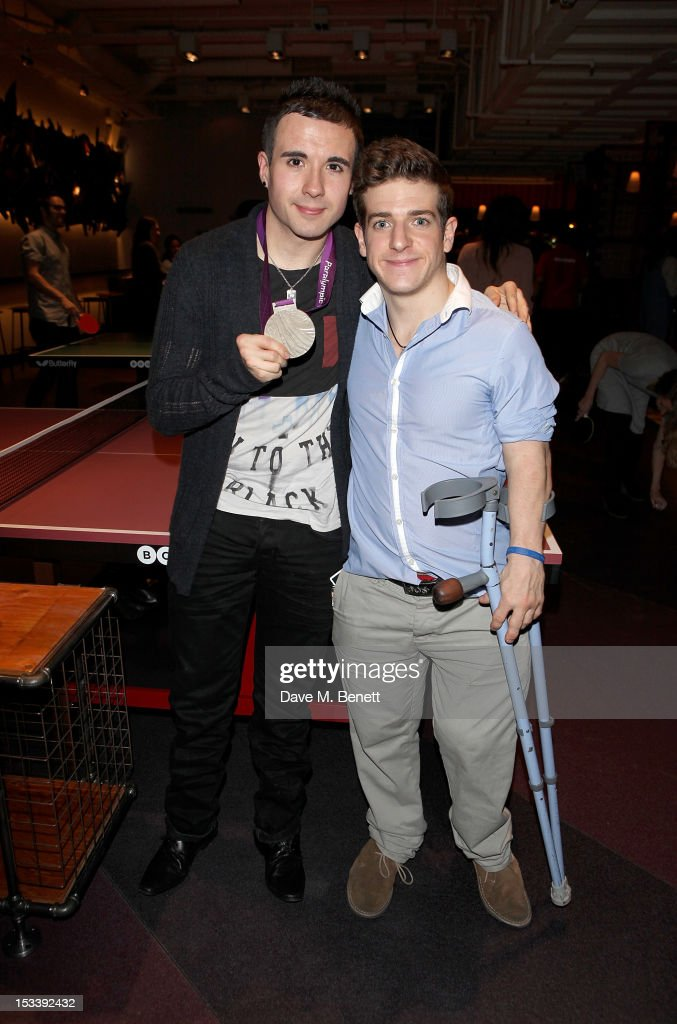 Paralympic Table Tennis players Will Bayley (L) and David Wetherill attend the launch of Bounce, Holborn's new Ping Pong club, on October 4, 2012 in London, England.