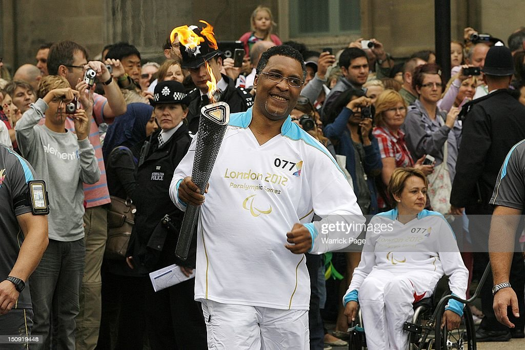 Paralympic torchbearer former boxer Michael Watson carries the Paralympic Torch in Trafalgar Square on August 29, 2012, in London, England.