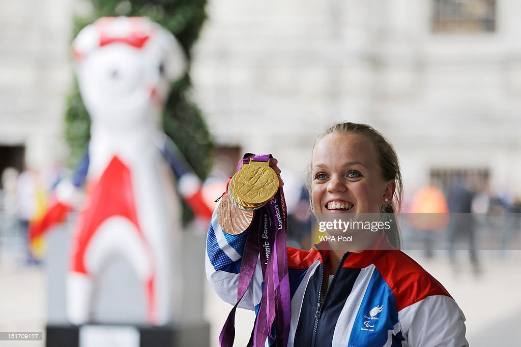 Paralympics GB gold medallist swimmer Ellie Simmonds poses with her medals before attending a reception for Team GB and Paralympic GB athletes, hosted by British Prime Minister David Cameron on September 10, 2012 in London, England. Thousands of people waving British flags lined the streets of London earlier on Monday for the London 2012 Victory Parade for Team GB and Paralympic GB athletes, to toast the athletes behind the country's unprecedented summer of sporting success.