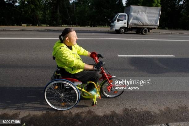 Paralyzed Ukrainian Oleg Ivanenko rides on handsbike by using only biceps and muscles of his hands as he tries to set a unique world triathlon record...