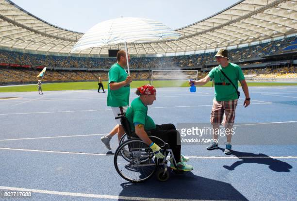Paralyzed Ukrainian Oleg Ivanenko rides on wheelchairby using only biceps and muscles of his hands and his supporters accompany him as he tries to...
