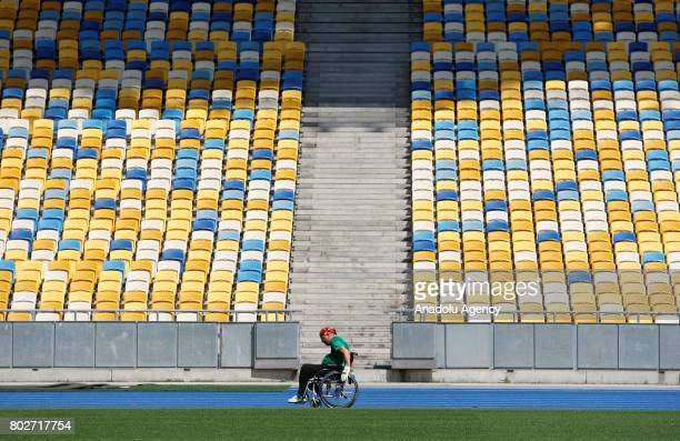 Paralyzed Ukrainian Oleg Ivanenko rides on wheelchairby using only biceps and muscles of his hands as he tries to set a unique world triathlon record...