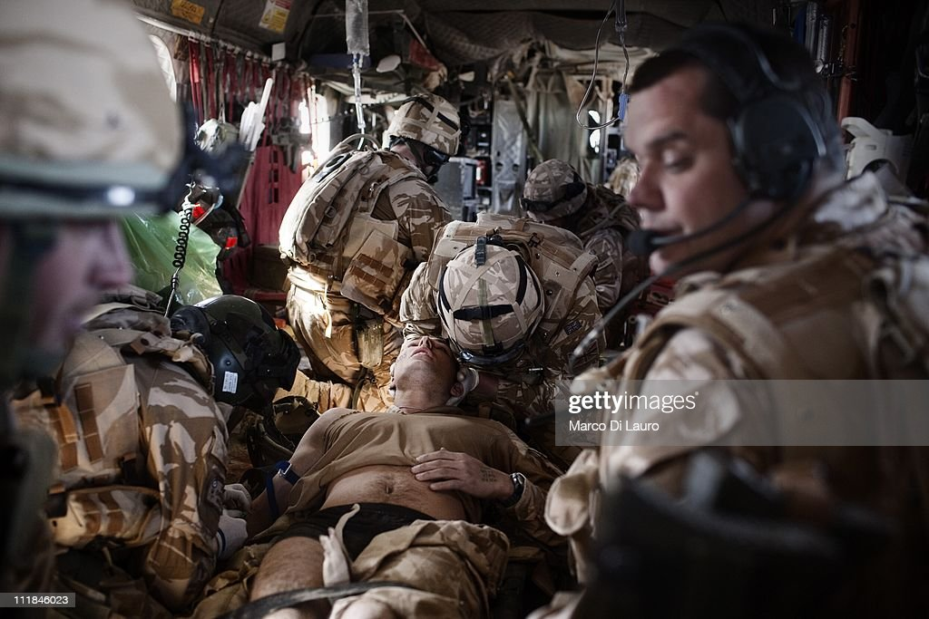 Paramedic CPL Shaun Leach 29yearsold from the RAF Cosford Medical Center and other MERT members treat two wounded British soldiers onboard of the...