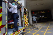 A paramedic opens the backdoor of an ambulance at the Queen Mary Hospital where Tongan King George Tupou V died in Hong Kong on March 19 2012 Tonga's...