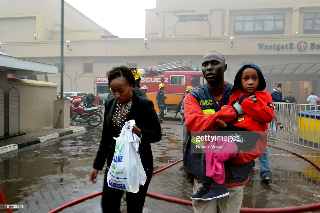 A Paramedic recues a child at the site of the terrorist attack Westgate Mall on September 21 2013 in Nairobi Kenya The attack occurred on Saturday...