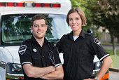 Paramedic team portrait standing in front of ambulance