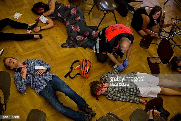 A paramedic treats participants during an emergency terrorism attack drill on Septermber 19 2014 in Prague Czech Republic Paramedics from some...