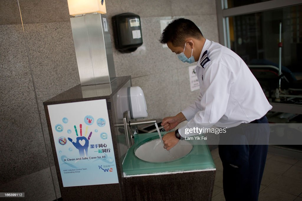 A paramedic washes hands outside the Princess Margaret Hospital on April 12, 2013 in Hong Kong. Local authorities have stepped up the testing of live poultry imports from China to include a rapid test for the H7N9 'bird flu' virus. Measures were put in place as the tenth victim of the influenza strain was confirmed in mainland China yesterday.