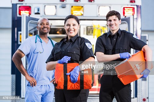 Paramedics and doctor outside ambulance