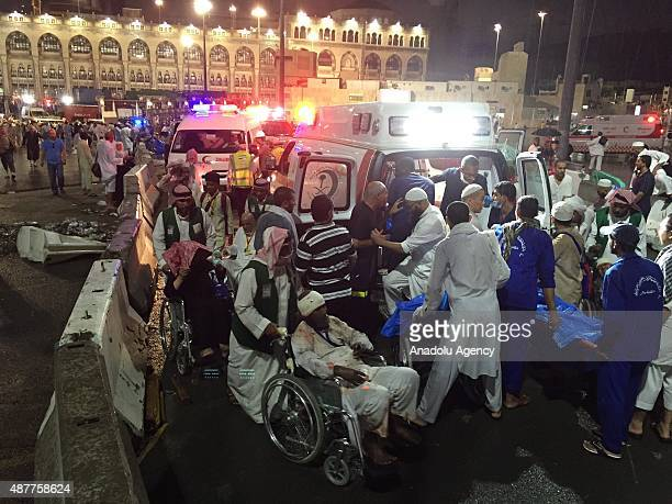 Paramedics and officals hospitalize wounded people after a construction crane collapsed over the Muslim pilgrims around the Muslims' holy place Kaaba...