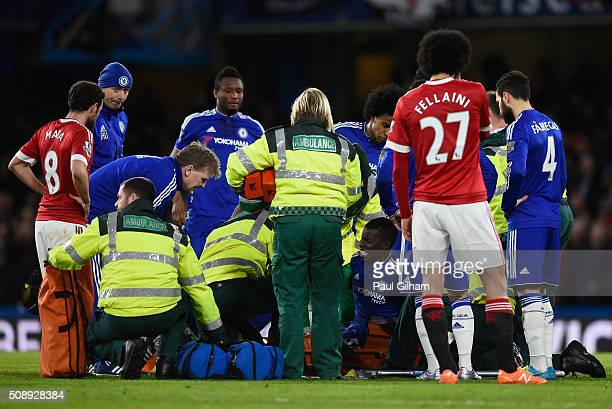 Paramedics and players surround Kurt Zouma of Chelsea after picking up an injury during the Barclays Premier League match between Chelsea and...
