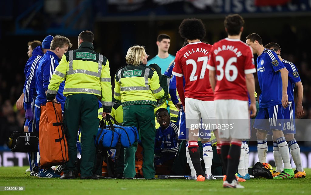 Paramedics and players surround <a gi-track='captionPersonalityLinkClicked' href=/galleries/search?phrase=Kurt+Zouma&family=editorial&specificpeople=7905425 ng-click='$event.stopPropagation()'>Kurt Zouma</a> of Chelsea after picking up an injury during the Barclays Premier League match between Chelsea and Manchester United at Stamford Bridge on February 7, 2016 in London, England.