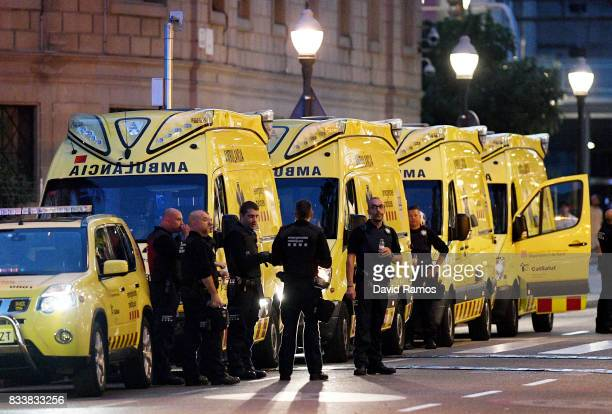 Paramedics are seen near to the scene of a terrorist attack in the Las Ramblas area on August 17 2017 in Barcelona Spain Officials say 13 people are...