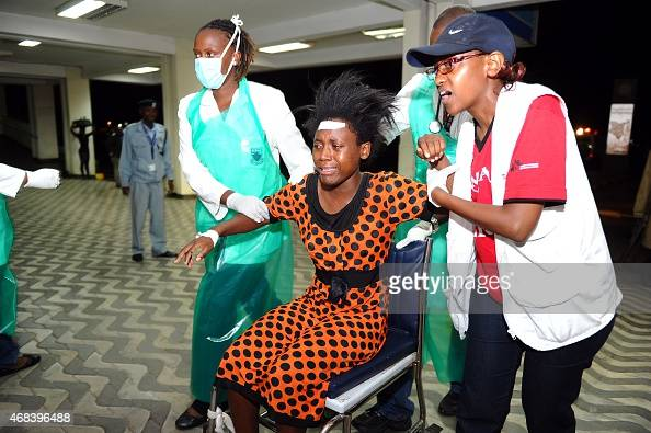 Paramedics attend to an injured Kenyan student as she is wheeled into Kenyatta National Hospital in Nairobi on April 2 following an attack at Garissa...
