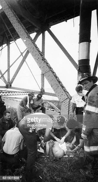 Paramedics attend to worker John Mansfield who fell about 35 feet from the Long Island Bridge on June 22 during a repair project Mansfield sustained...