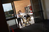Paramedics bring an injured child into the emergency room of the nonprofit Children's Hospital on September 14 2009 in Aurora Colorado Although a...