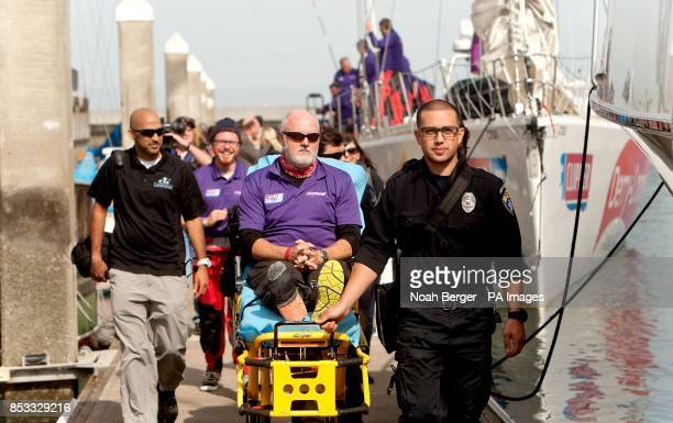 Paramedics carry British sailor Andrew Taylor on a stretcher as the Derry~Londonderry~Doire arrives in San Francisco on Friday April 11 during the...