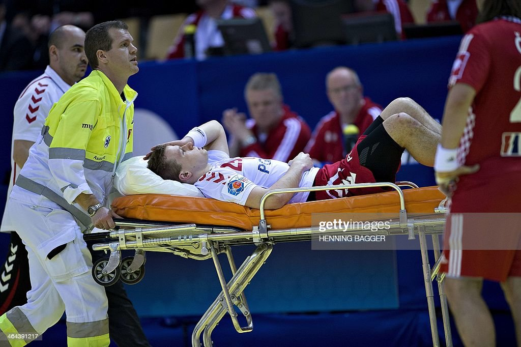 Paramedics carry Poland's injured right wing Jakub Lucak on a stretcher during the men's EHF Euro 2014 Handball Championship main group B match Poland vs Croatia on January 22, 2014 at the NRGi Arena in Aarhus, Denmark. Croatia won 28-31 and advances to the semi-finals.