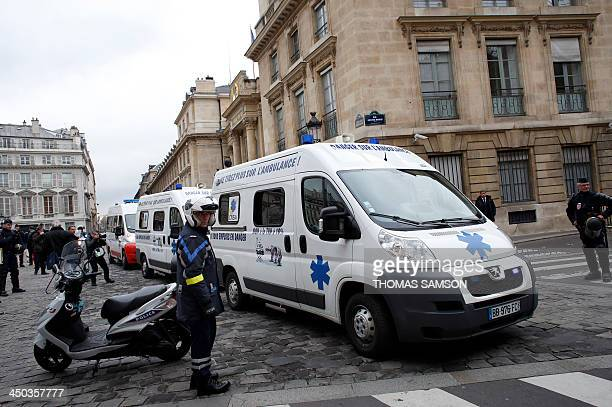 Paramedics drive their ambulances towards the French National Assembly on November 18 2013 in Paris to protest against a ValueAdded Tax rise from a...