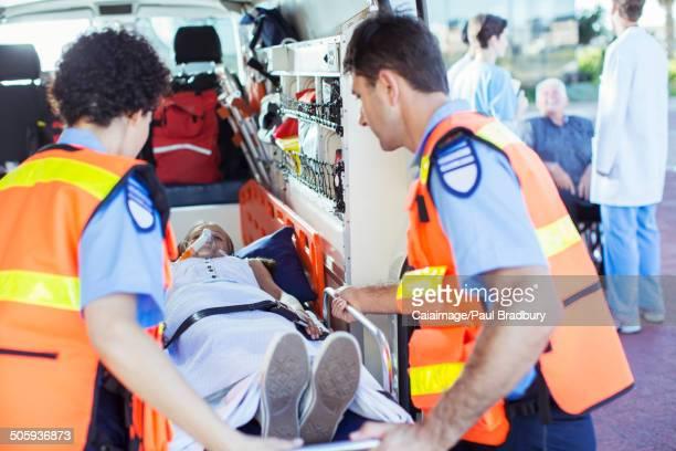 Paramedics examining patient in ambulance