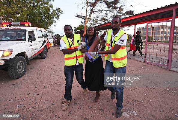 Paramedics help a student who was injured during an attack by Somalia's AlQaedalinked Shebab gunmen on the Moi University campus in Garissa on April...