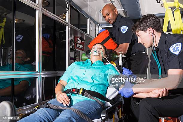 Paramedics helping a patient