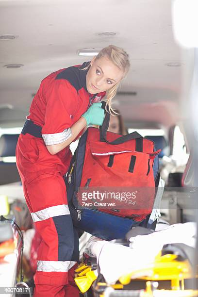 Paramedics in ambulance checking equipment