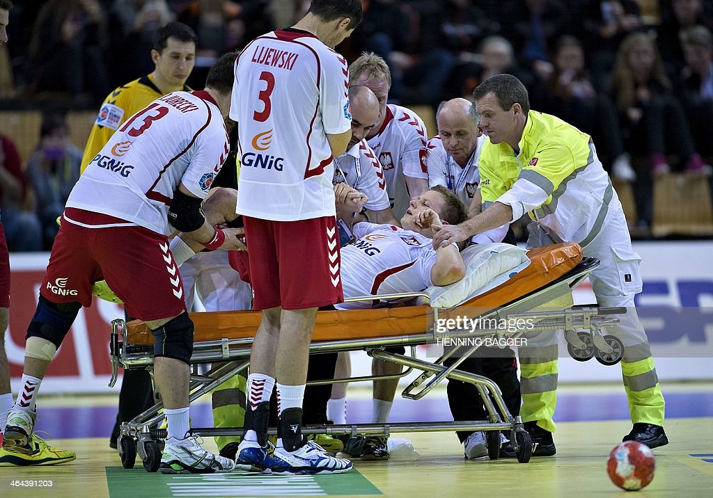 Paramedics lay Poland's injured right wing Jakub Lucak on a stretcher during the men's EHF Euro 2014 Handball Championship main group B match Poland vs Croatia on January 22, 2014 at the NRGi Arena in Aarhus, Denmark. Croatia won 28-31 and advances to the semi-finals.