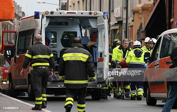 Paramedics place an injured fireman into an ambulance after another earthquake shock in downtown Finale Emilia in the Modena province on May 20 2012...